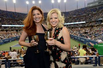 Debra Messing and Megan Hilty attend the Moet & Chandon Suite at the US Open.