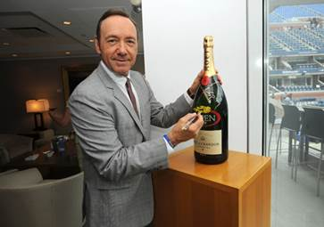 Kevin Spacey signed a Moet & Chandon Imperial bottle for charity at the 2013 US Open.