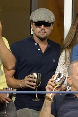 Leonardo DiCaprio enjoys the matches from the Moet & Chandon Suite at the US Open.