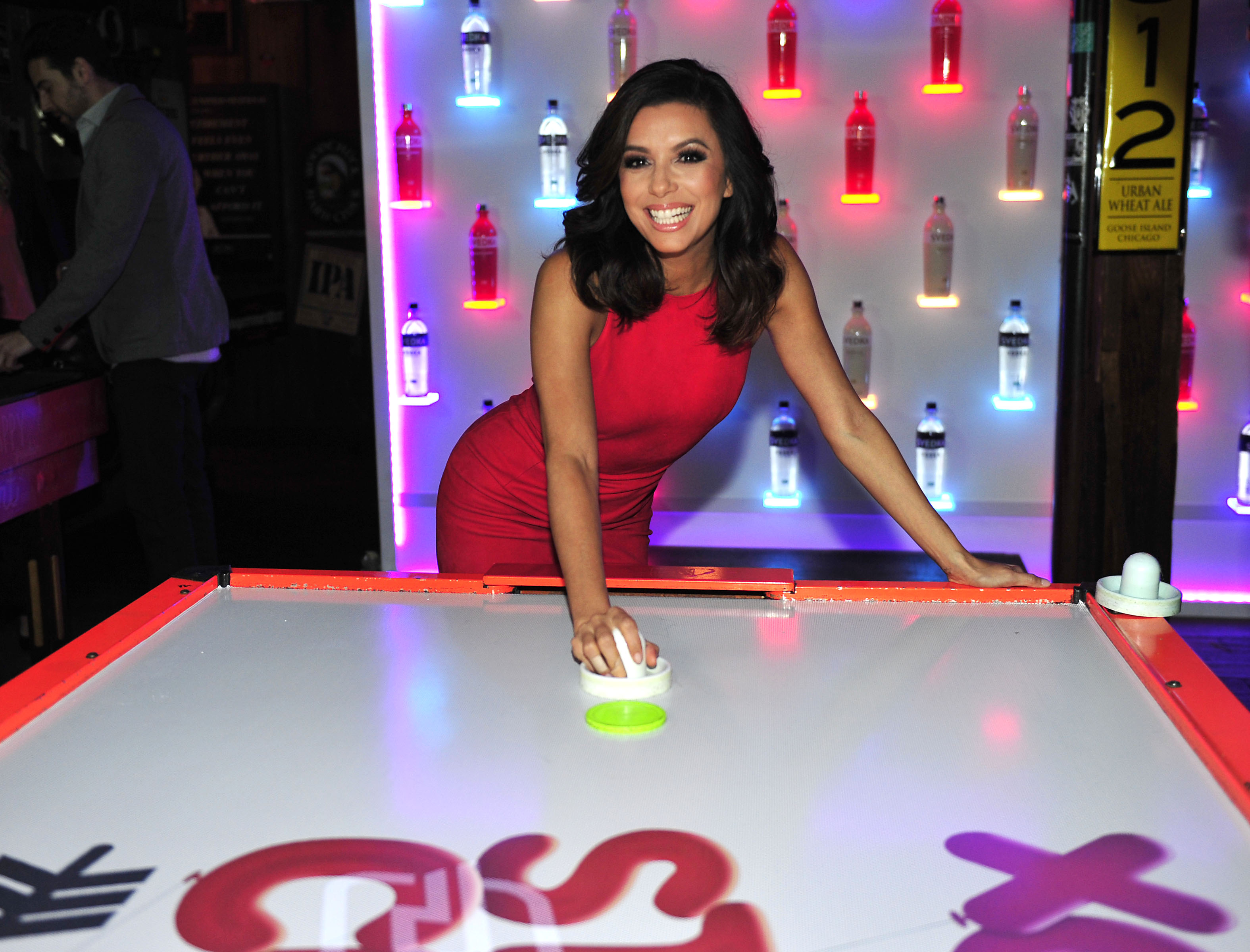 Eva Longoria Playing Air Hockey