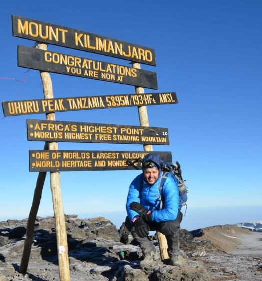 Simon Ford atop Mount Kilimanjaro
