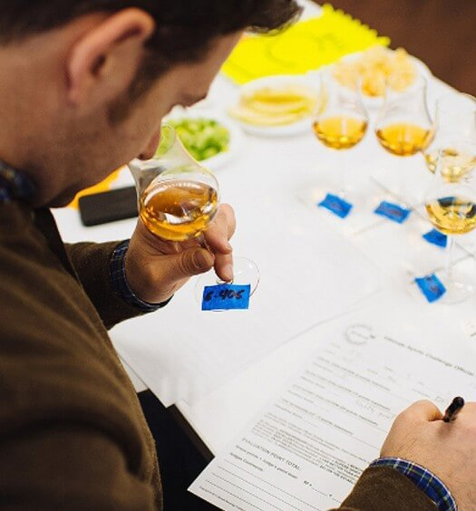 A judge for Ultimate Spirits Challenge 2015 nosing for a winner, a detailed process.