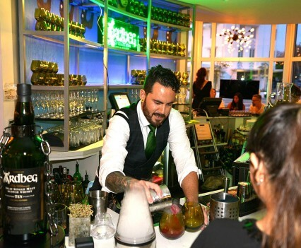 Vagabond Hotel bartender serving a custom crafted Ardbeg cocktail