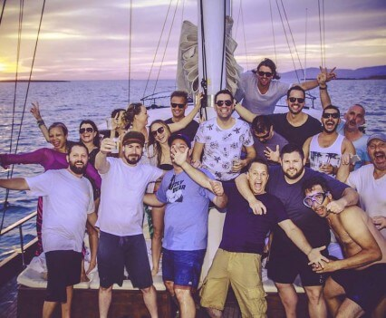 Bulldog Modern Gin & Tonic Competition Recap, group shot with sunset on boat