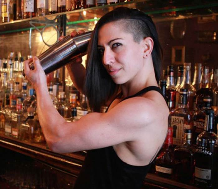 Lana Gailani, Mixologist for the Chilled 100 and other prestigous bars shaking up a cocktail behind the bar