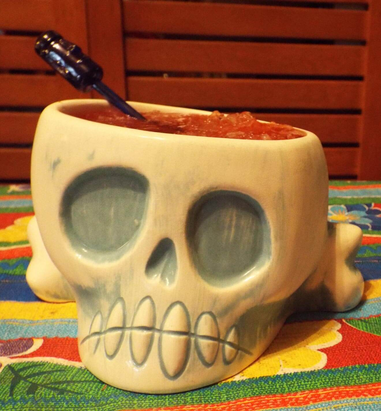 Cocktail in a shrunken skull for tiki party decor