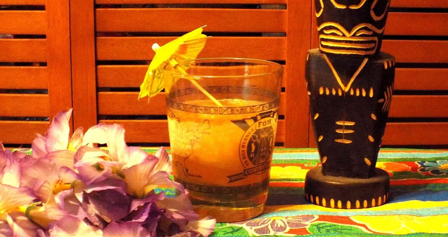 How to Host a Winter Tiki Party, mai tai cocktail display with tiki cups