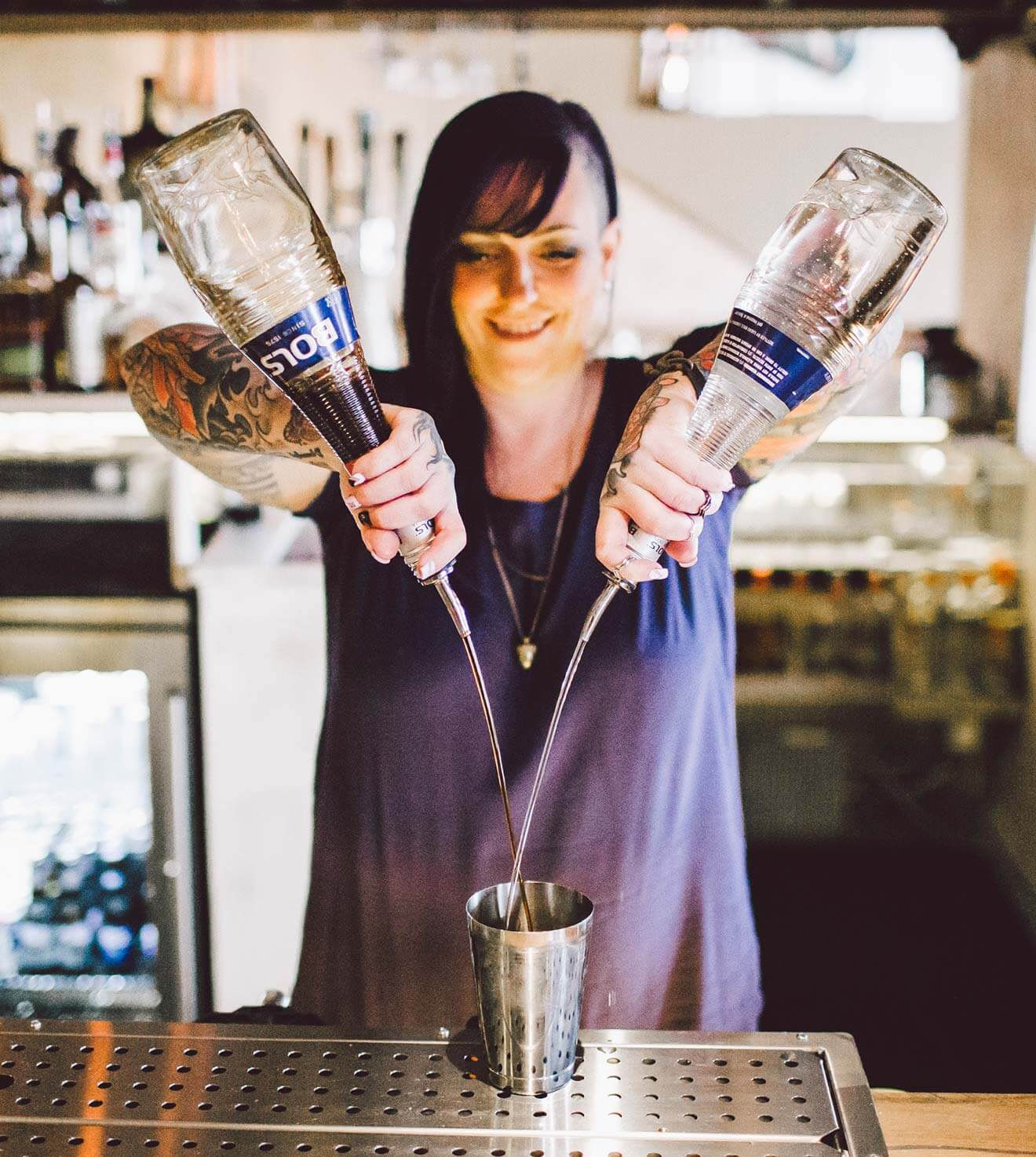 Mixologist Kate Gerwin pouring cocktails, what's chilling right now