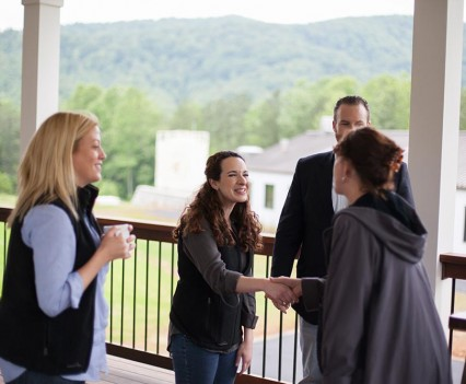 Amanda Beckwith, Guest Experience Manager, greets guests