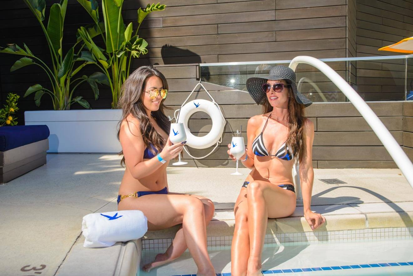 Ladies enjoying a GREY GOOSE cocktail at Liquid Pool and Lounge