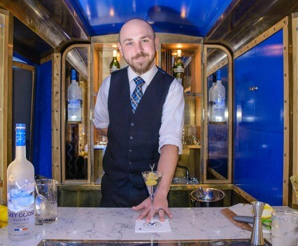 Mixologist Serving Cocktials in the GREY GOOSE Camionnette