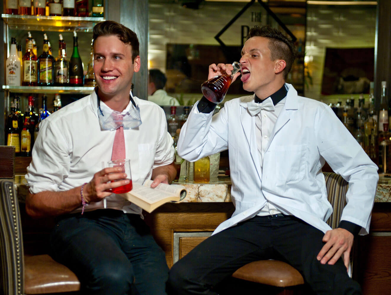 Gregory Lucas and Parker Boase Enjoying a Cocktail at the Bar