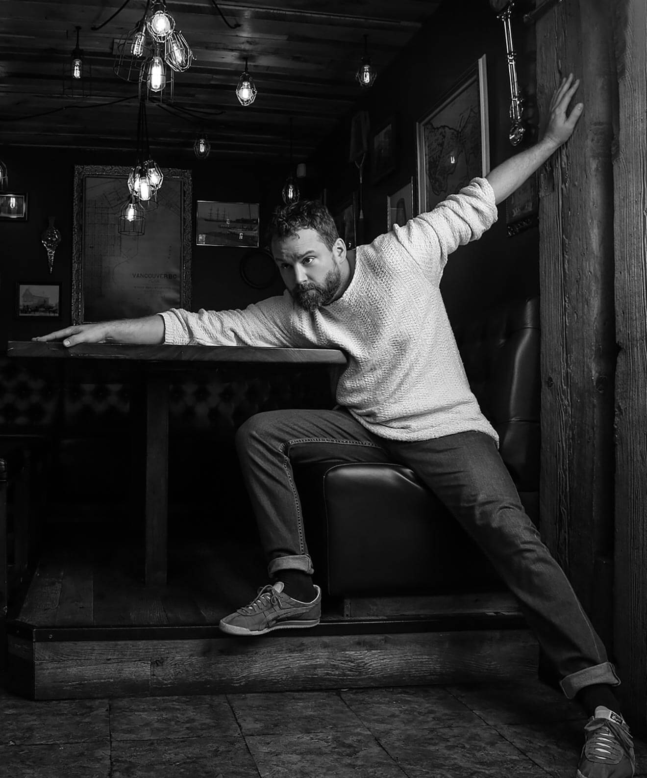 Chillin' with Patrick Gilmore, black and white pose at table