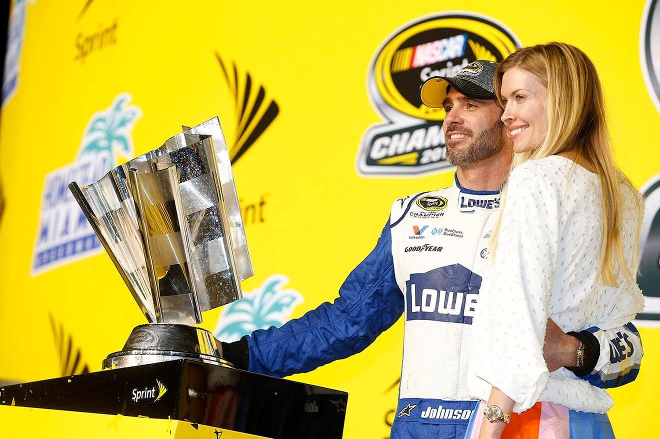 Jimmie-Johnson-accepting-award-with-wife