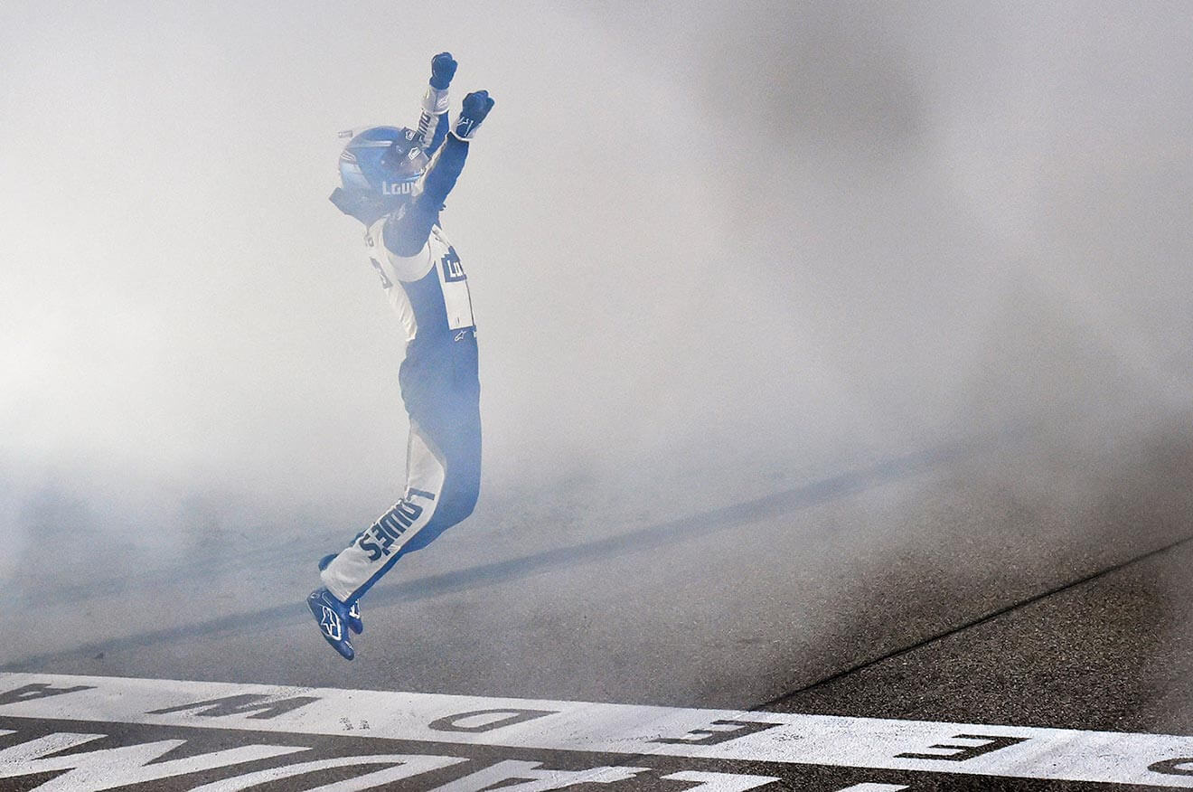 Jimmie-Johnson-victory-leap-at-finish-line