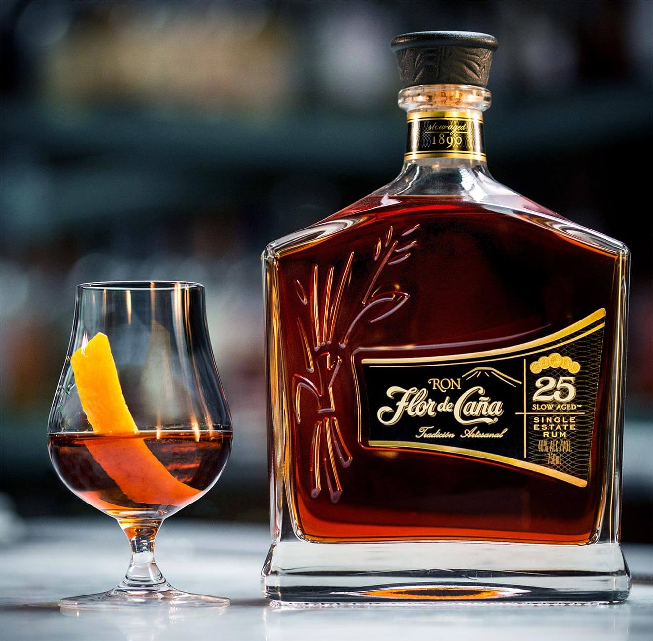 Flor de Caña Centenario 25, bottle and glass
