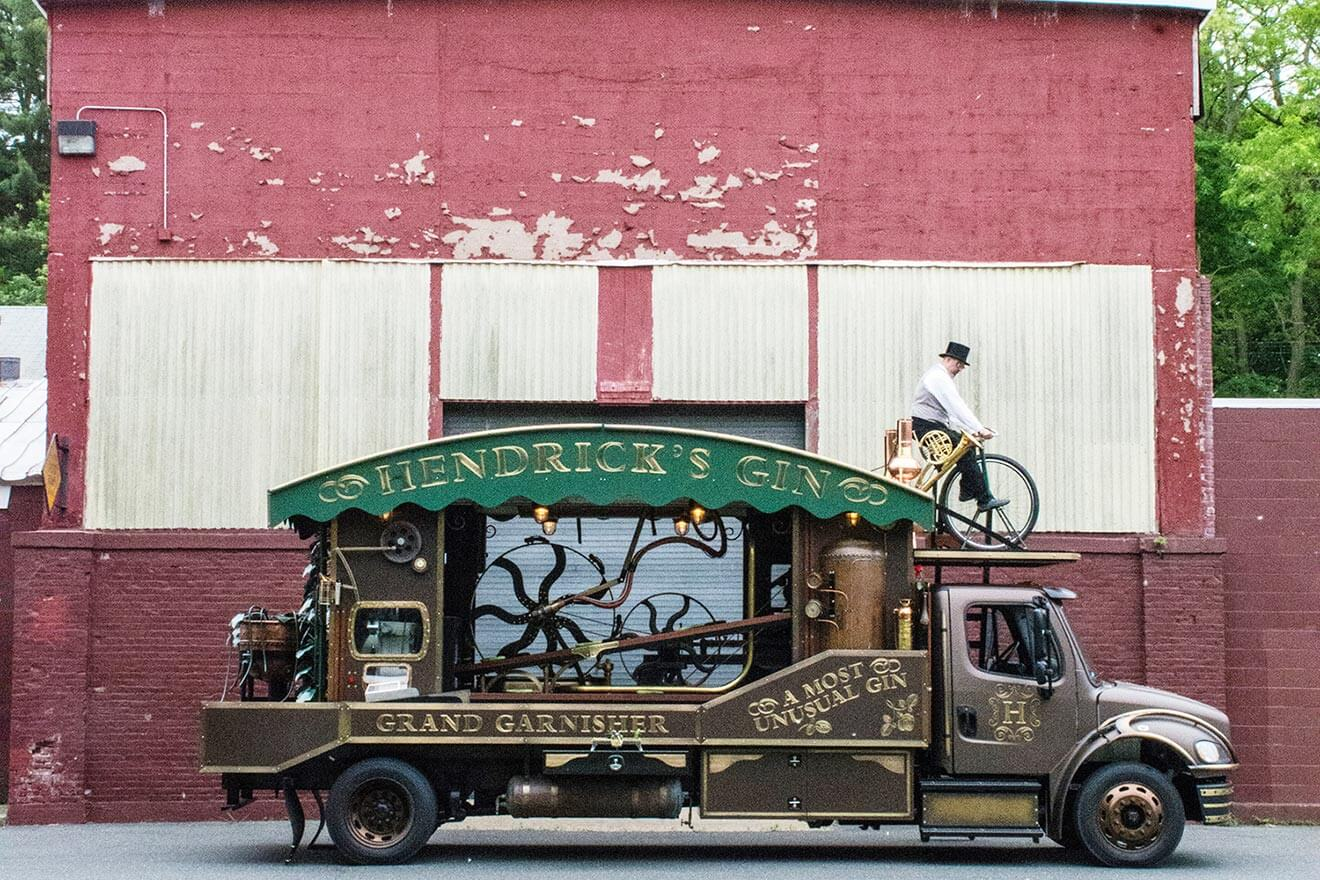 Hendrick's Gin Giant Cucumber Garnisher, truck against old building