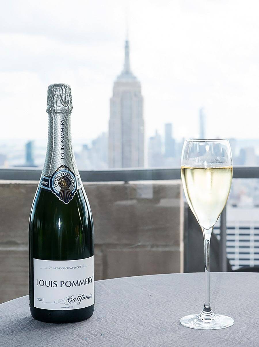Louis Pommery, glass and bottle, skyline view