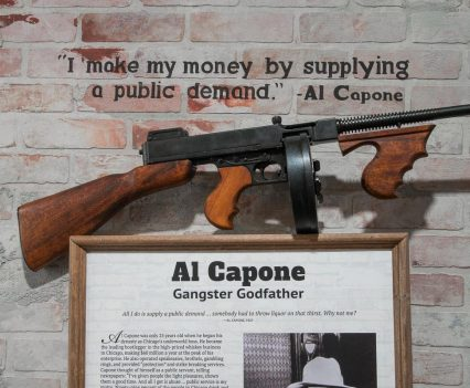 Al Capone display with article and gun