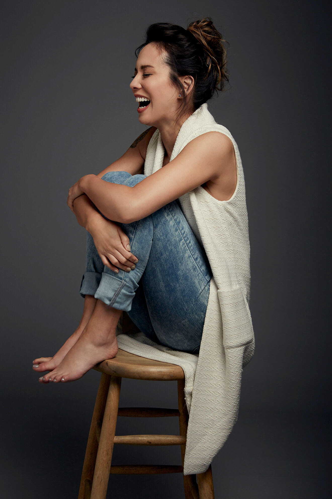 Chillin' with Lexa Doig, casual, indian style on stool laughing