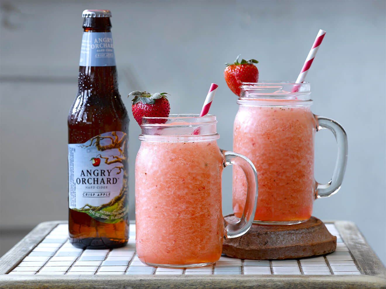 Angry Hard Cider Slushy, mason jar mugs with strawberry garnish