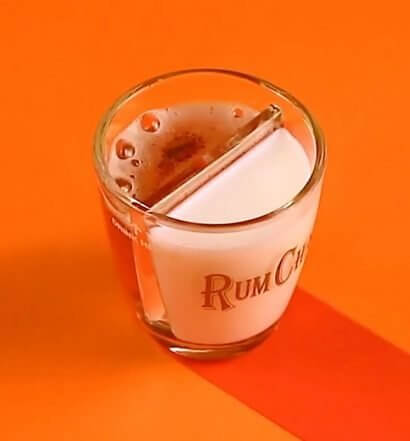 Chilled Drink of the Week: RumChata Pumpkin Bomb, cocktail on orange background
