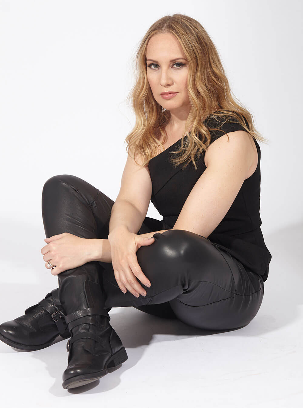 Chillin' with Kelly Karbacz, all black tank and leather pants, sitting