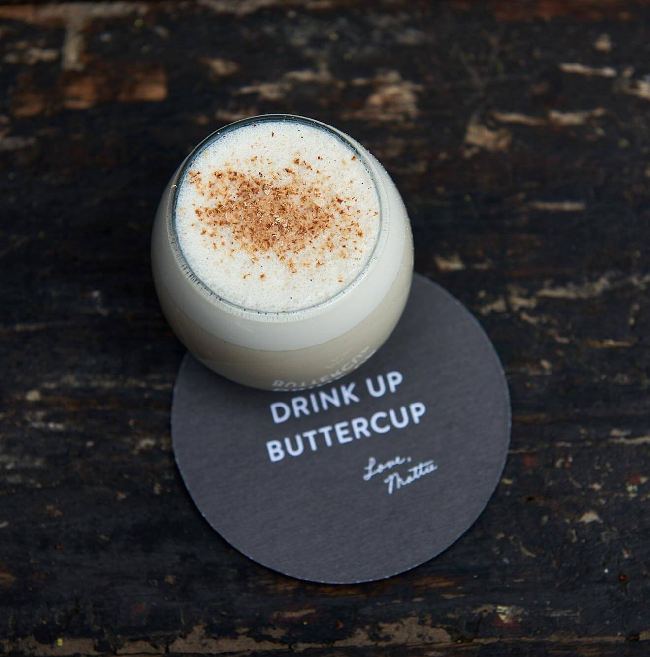 1965 Milk Punch, cocktail on coaster