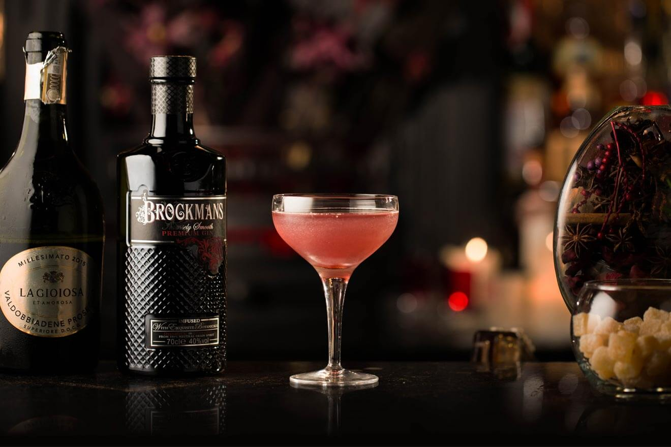Brockmans Satin Maroon, cocktail with bottle, garnish background
