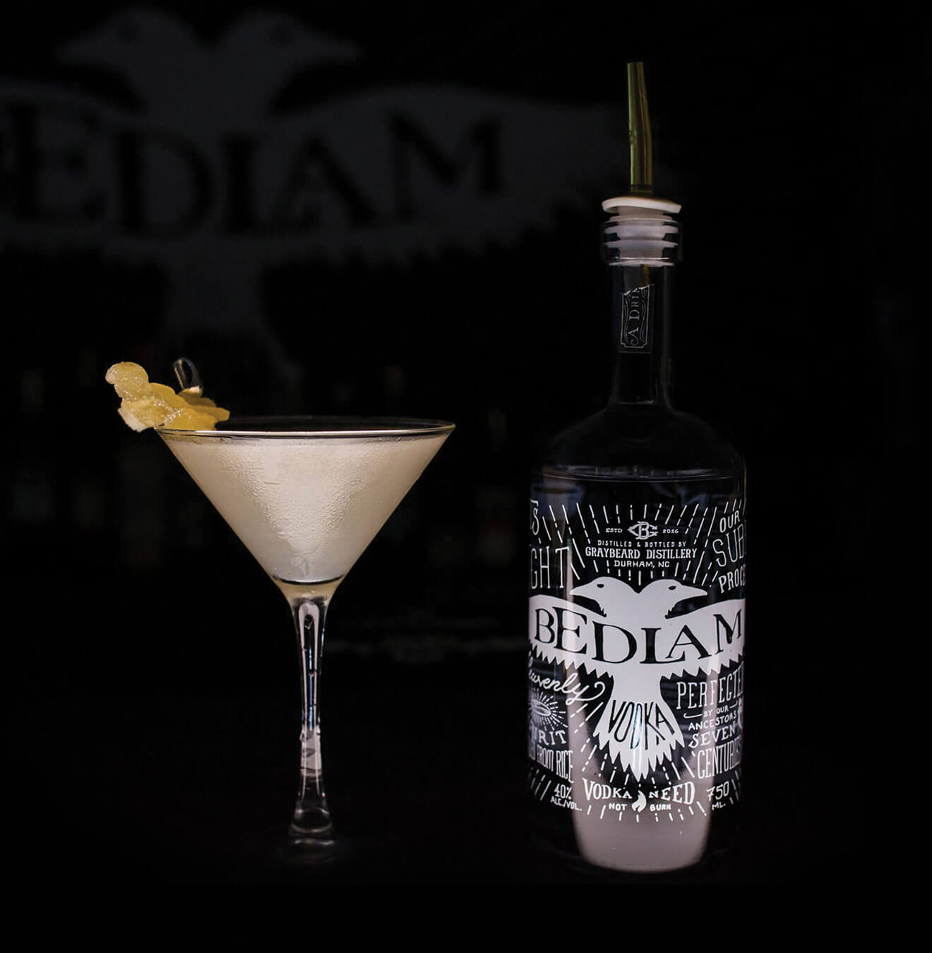 Bedlam Vodka with martini and bottle on black