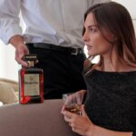 DISARONNO Launches New Television Commercial, screen with beautiful woman being served