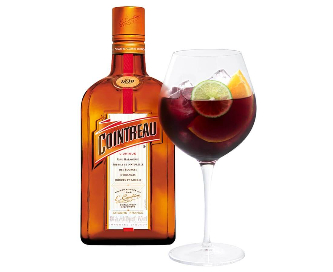 Holiday Sangria, cocktail and bottle on white