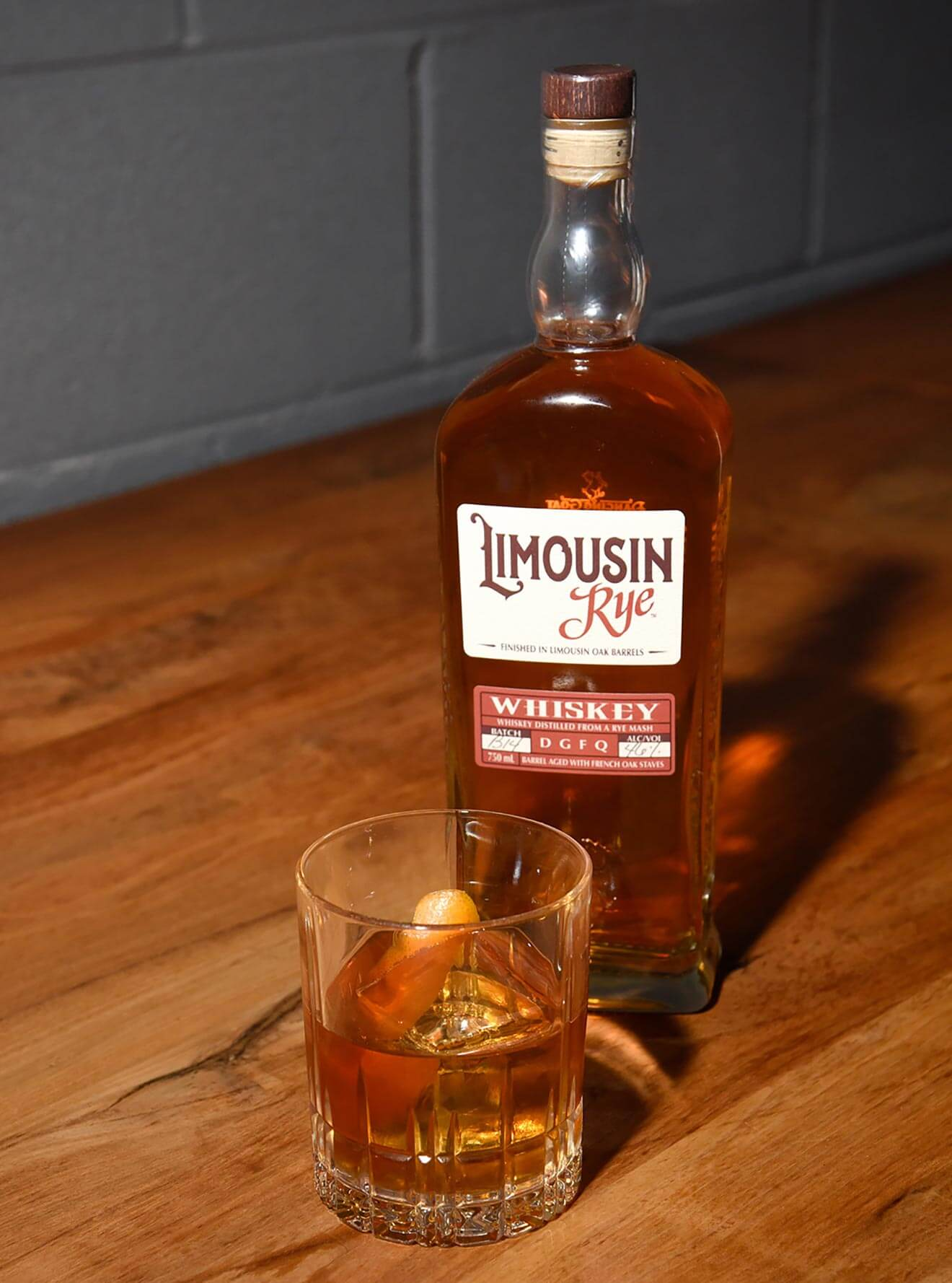 Limousin Rye Salted Maple Old Fashioned, cocktail and bottle