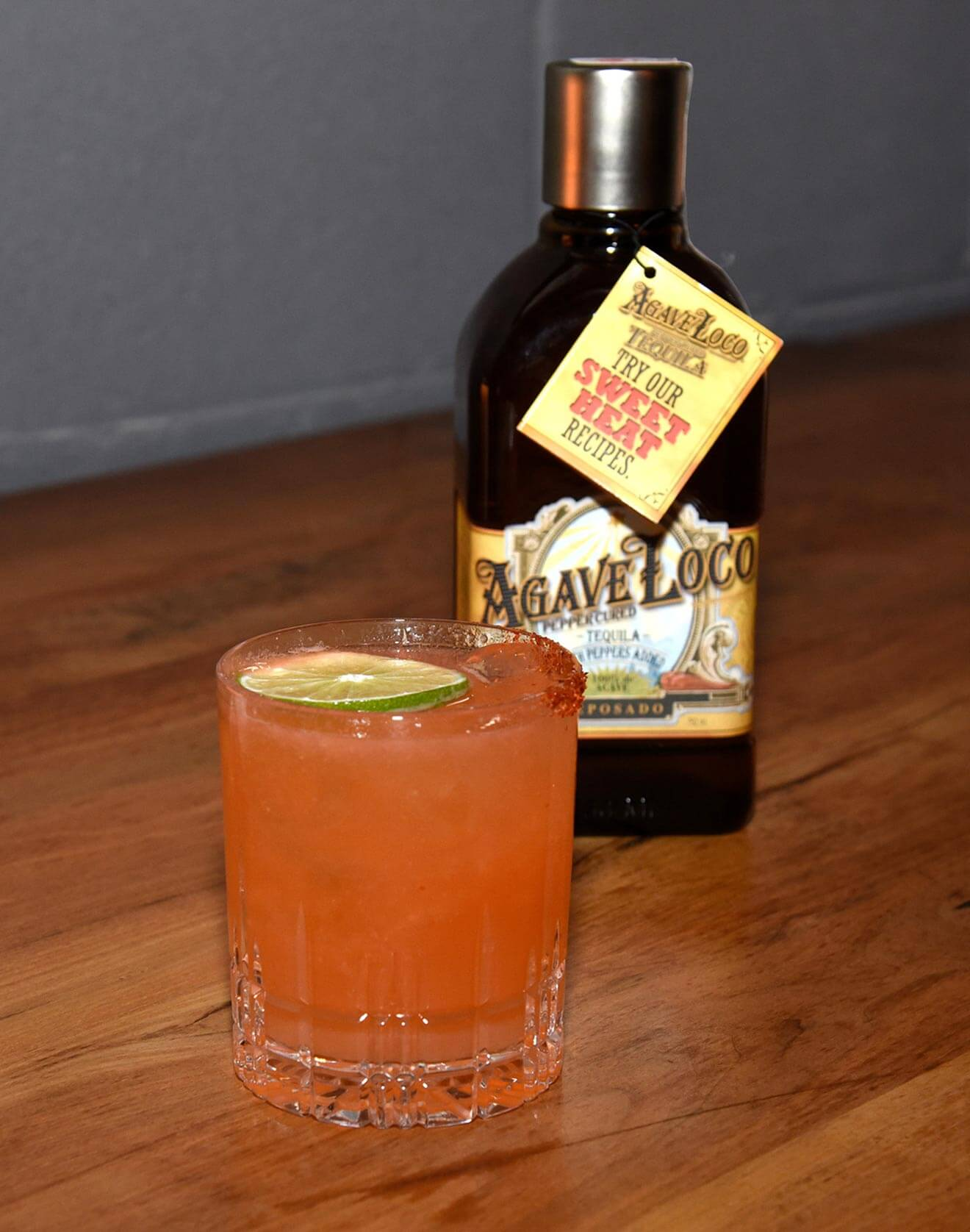 Spicy Agave Loco Paloma cocktail with bottle