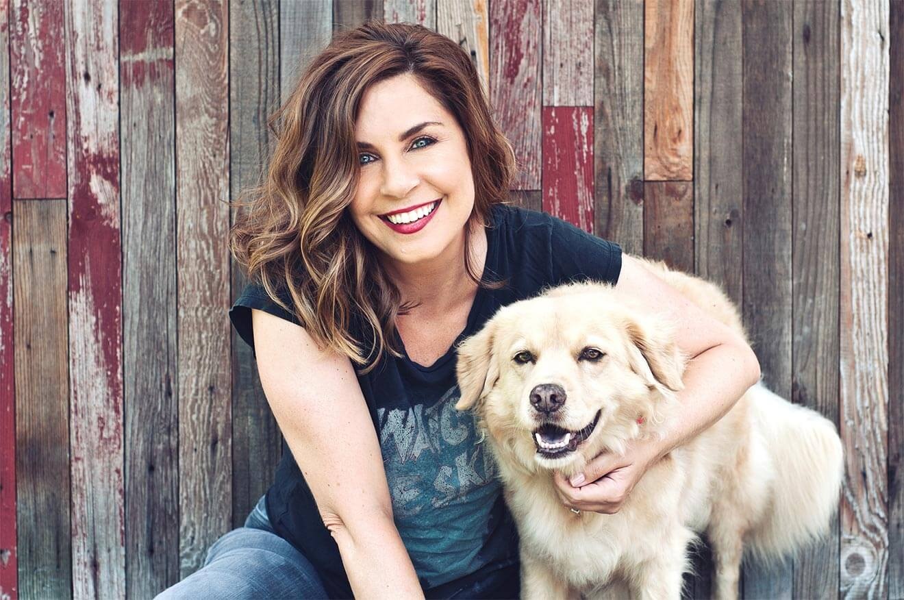 Chillin' with Allison King, with her dog in front of fence