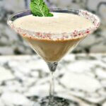 Peppermint Bliss martini cocktail with candy cane rim, featured image