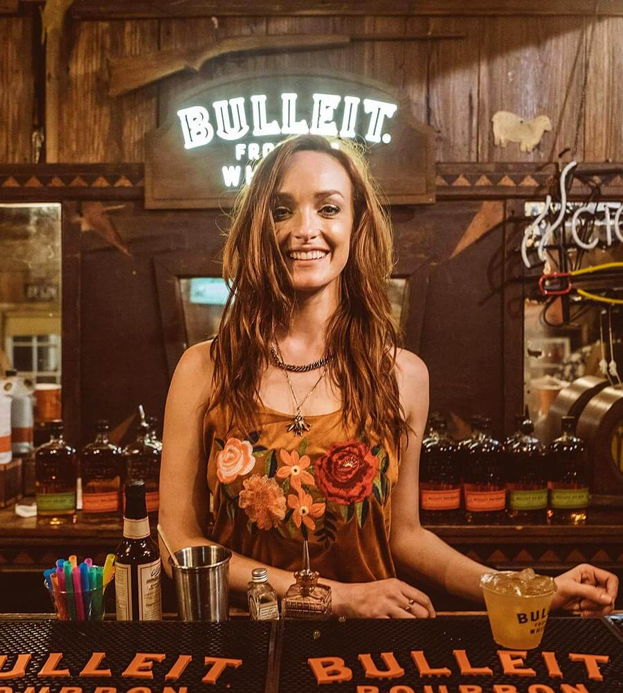 Anne Vaughn, Austin, Texas, bartending behind bar