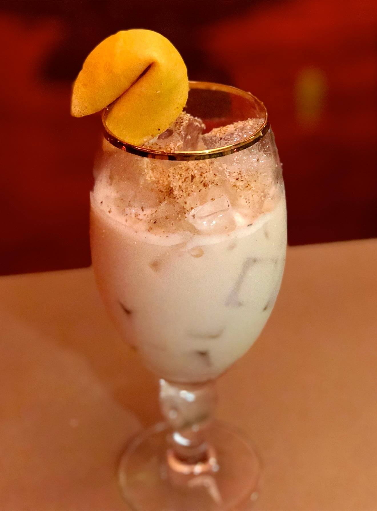 Fortune Cookie Milk Punch, cocktail with fortune cookie garnish