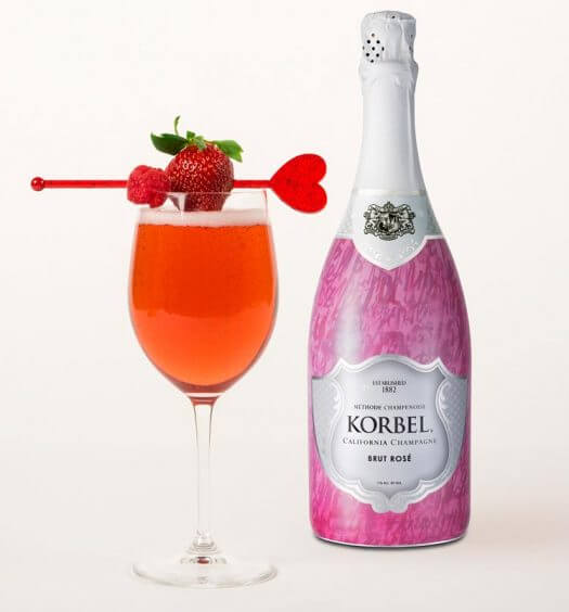 Korbel Ruby Rose, cocktail and bottle on light background, featured image