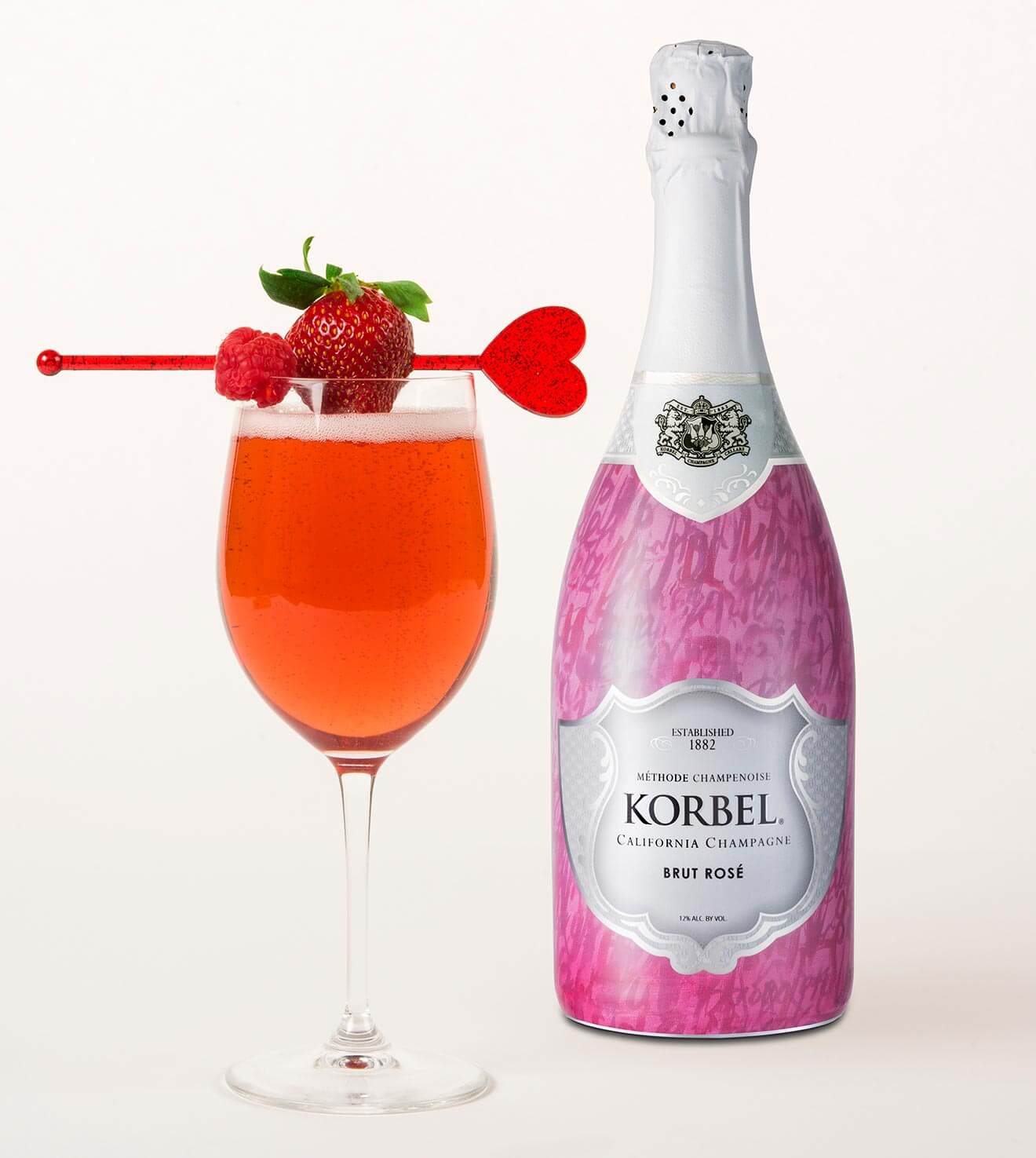 Korbel Ruby Rose, cocktail and bottle on white