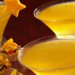 Mango Bellini cocktails with star mango garnish, featured image