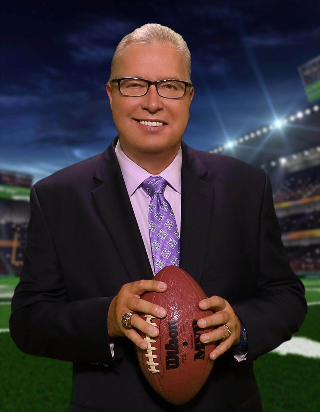 Ron Jaworski, portrait, suit with football, stadium back