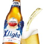 Amstel Xlight, bottle and glass on white, featured image