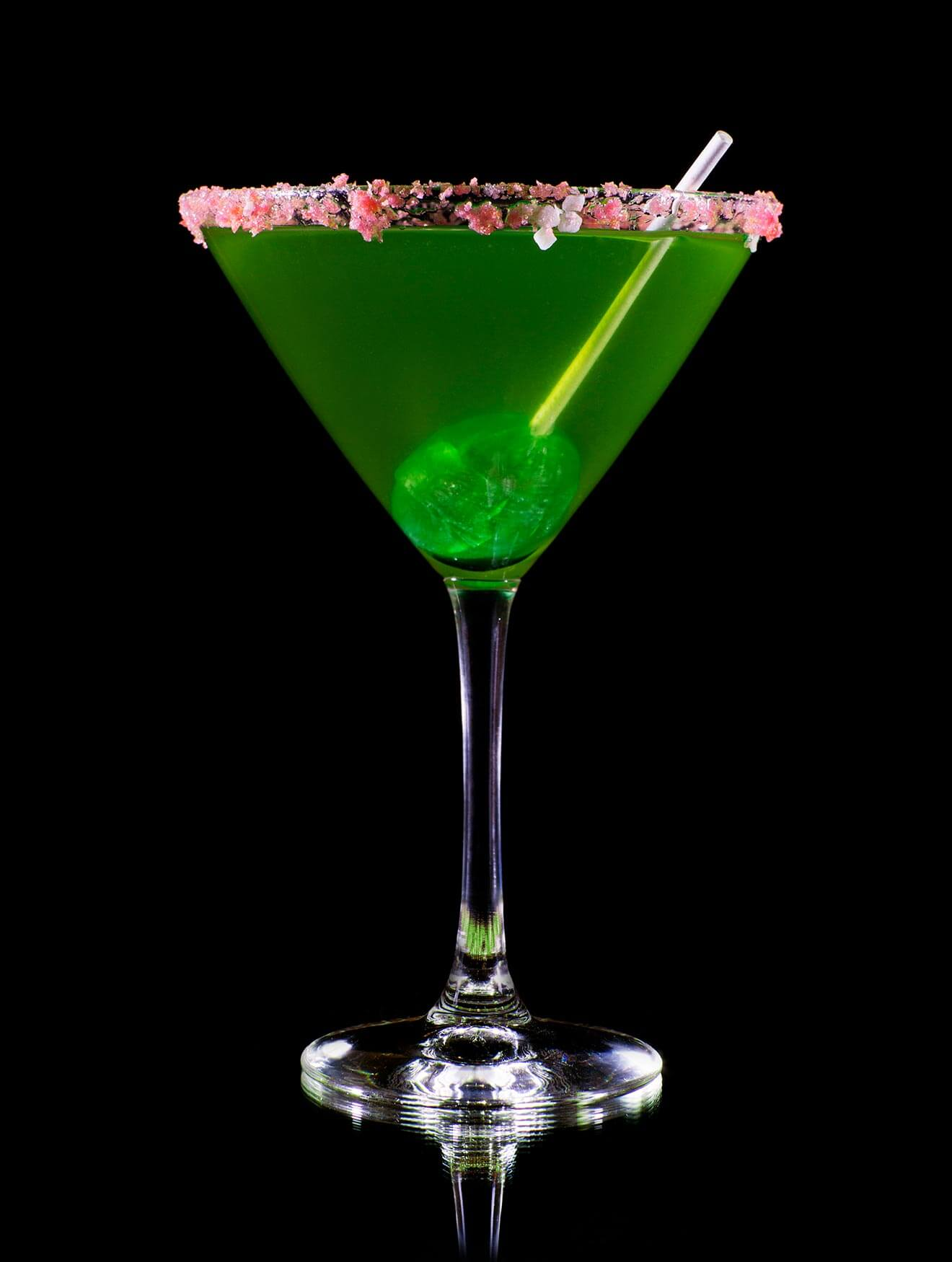 Sour Apple Lolly Martini, on black with lolly pop garnish