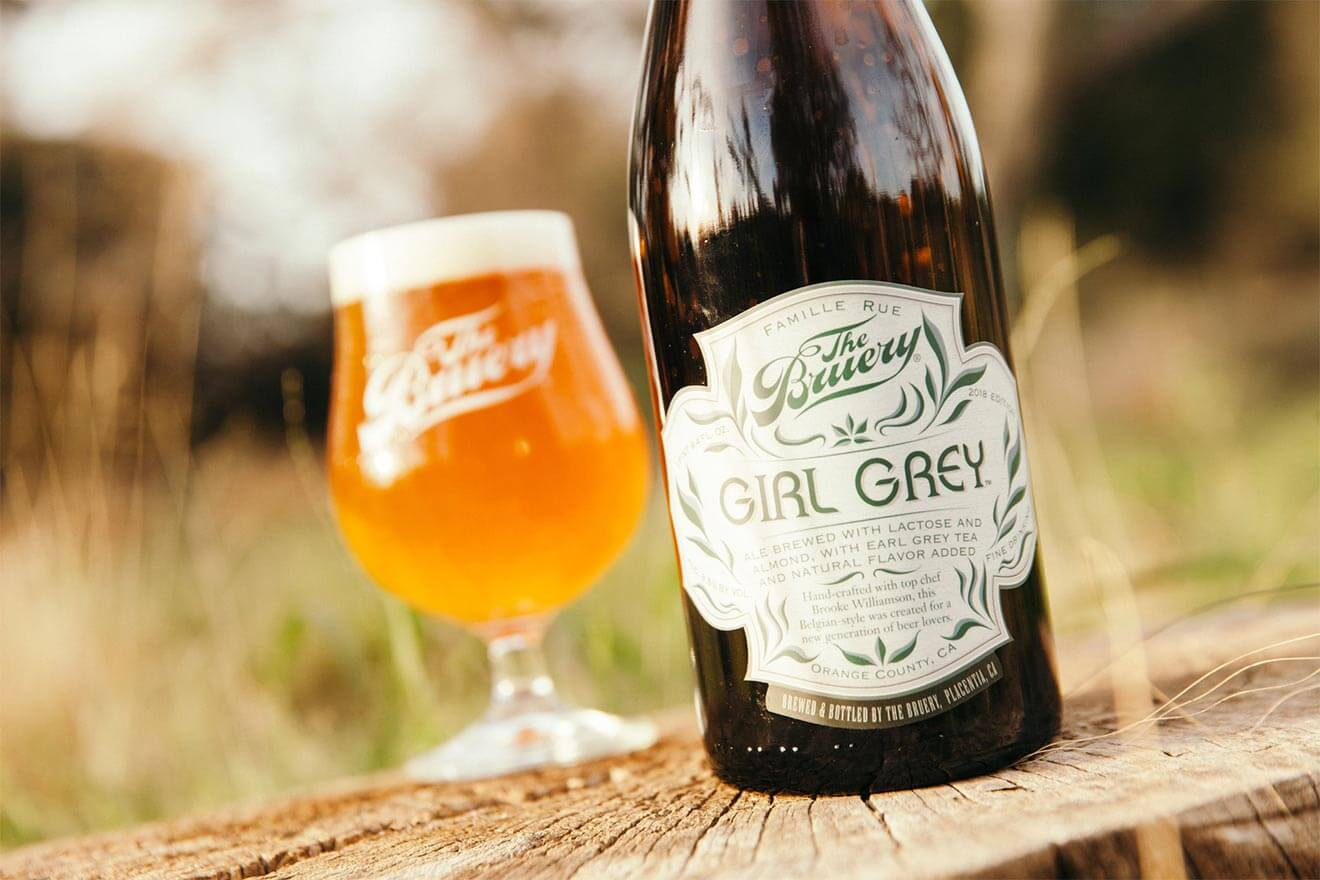The Bruery Girl Grey Brew, glass and bottle on outside table