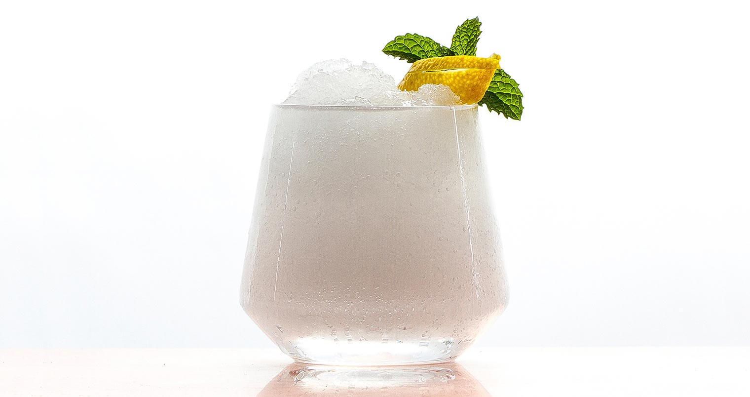 Absinthe Frappe, cocktail with garnish on white, featured image
