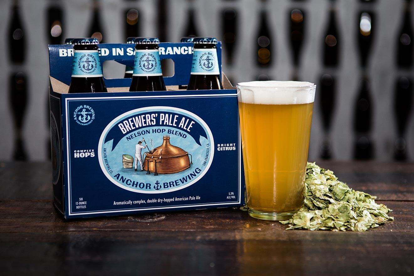 Anchor Brewing Brewers' Pale Ale, 6 pack and pint, hops on table