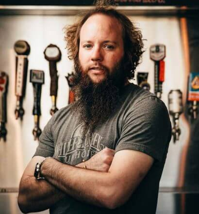 Justin Malone, serious with bar taps, featured image