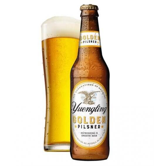 Yuengling's Golden Pilsner, bottle and glass on white, featured image