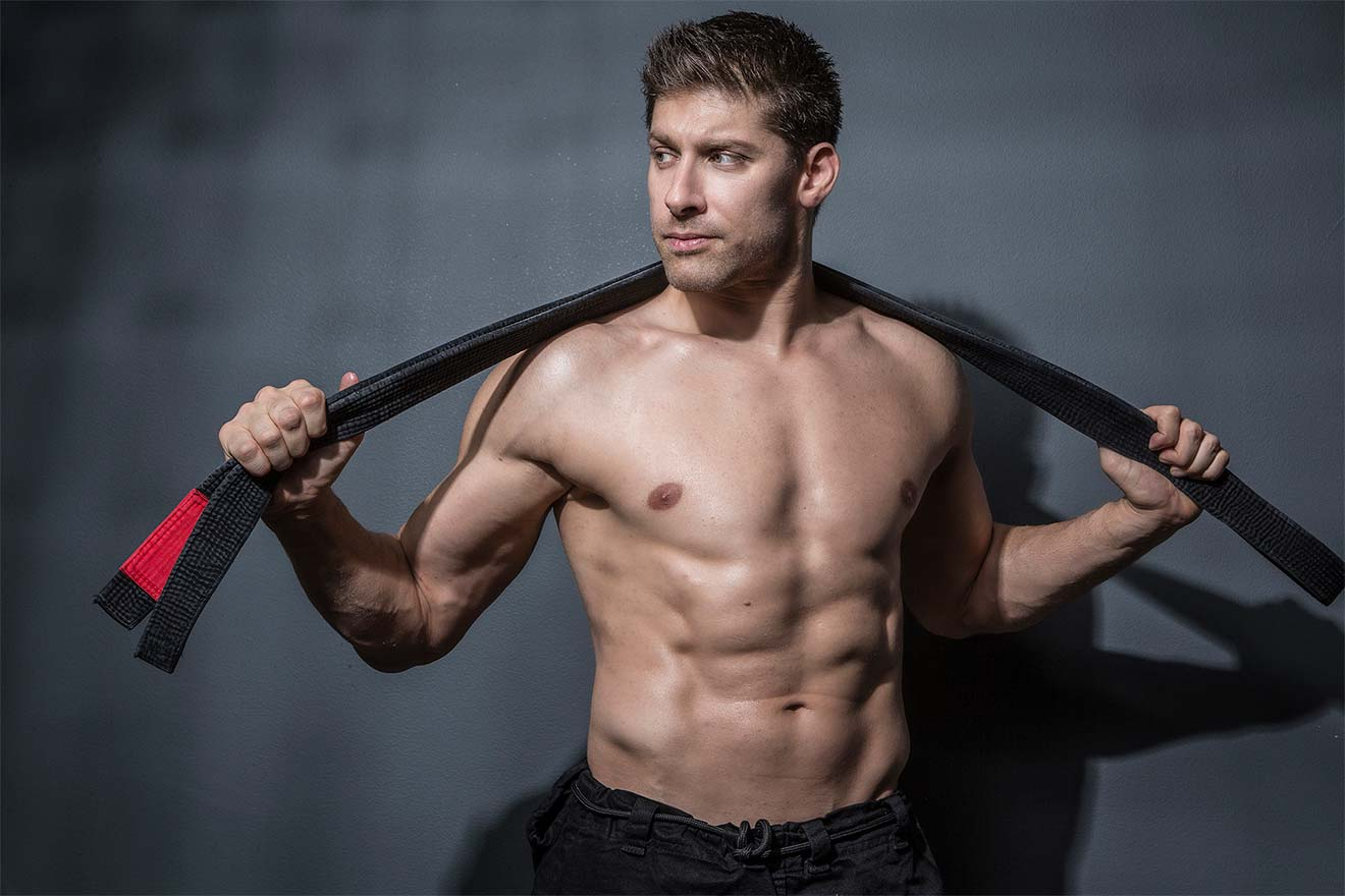Chillin' with Alain Moussi, martial arts pose with weapon